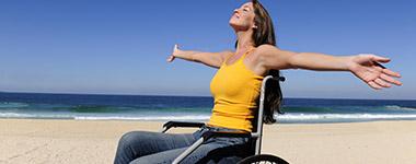 woman in wheelchair at the beach