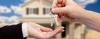 giving keys to new home owner