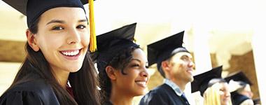 group of graduates with graduation caps